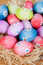 Easter eggs decorated with daisies on a nest of straw and wooden background Royalty Free Stock Images