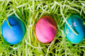 Easter eggs decorated on plastic grass Stock Images