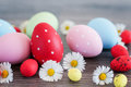 Easter eggs different color egg on an old wood Royalty Free Stock Photography