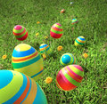 Easter eggs are falling on the grass Stock Images