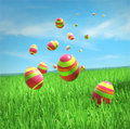Easter eggs are falling on the grass under sky Royalty Free Stock Photos