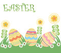 Easter eggs and flowers in grass decorated with daisies cartoon the with the word Stock Photography