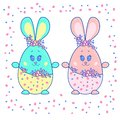 Easter eggs in the form of hares. Boy and girl.