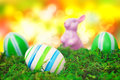 Easter eggs in front of bokeh dekoration with colorful egs a moss background picture is toned Royalty Free Stock Photos