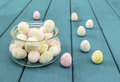 Easter eggs in glass pot on bright azure wooden planks toned selective focus Royalty Free Stock Photo