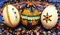 Easter eggs with glass stones decoration still life three decorated on the blue cloth and jewel Stock Photo