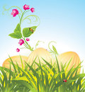 Easter eggs in the grass with flowers Stock Photo