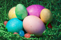 Easter eggs in grass with jelly beans close up glitter and Stock Image