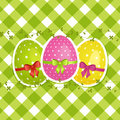 Easter eggs on a green gingham border Stock Image