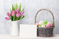 Easter eggs, greeting card and pink tulips Royalty Free Stock Photo