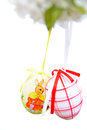 Easter eggs hanging on branch white background Stock Photography
