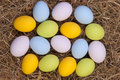 Easter eggs on hay Stock Photos