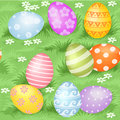 Easter eggs hidden in green grass seamless pattern multi colored background Royalty Free Stock Photography