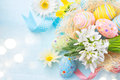 Easter eggs in the nest with spring flowers Royalty Free Stock Photo