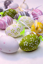 Easter eggs one near the other surrounded by white background its an image vertically Stock Image
