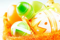 Easter eggs in orange basket Royalty Free Stock Photo