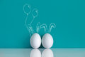 Easter eggs painted with ears and balloons on the blue background Royalty Free Stock Photo
