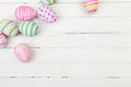 Easter eggs painted in pastel colors on a white wood background Stock Image