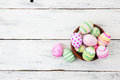 Easter eggs painted in pastel colors on white wood wooden background Royalty Free Stock Photography