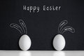 Easter eggs with painted rabbits on the black background Royalty Free Stock Photo