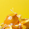 Easter eggs painted on a yellow background Royalty Free Stock Image