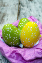 Easter eggs on a pink nest surrounded by rustic background is an image vertically Royalty Free Stock Image