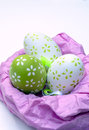 Easter eggs on a pink nest surrounded by white background is an image vertically Royalty Free Stock Photography