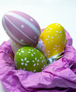 Easter eggs on a pink nest surrounded by whitebackground its an image vertically Stock Photography