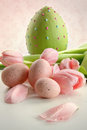 Easter eggs and pink tulips with vintage feeling Royalty Free Stock Photography