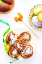Easter eggs with plate of sweet rolls Stock Photo