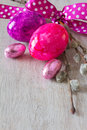 Easter eggs pussy willow bow with ribbon in and purple and lilac copy space Royalty Free Stock Image