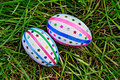 Easter eggs with ribbons and sequins on grass two decorated multicolored braid sparkles as asterisks green top Stock Image