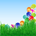 Easter eggs roll into the grass