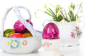 Easter eggs and snowdrops in old tableware Stock Image