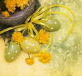 Easter eggs and spring flowers yellow background Stock Photography