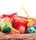 Easter eggs in a straw basket Stock Photo