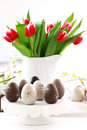 Easter eggs tulips table Royalty Free Stock Image