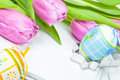 Easter eggs, tupils and easter recipe book Stock Photos