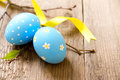 Easter eggs and twigs on old wooden background close up horizontal copy spase Royalty Free Stock Image