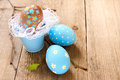 Easter eggs and twigs on old wooden background close up horizontal copy spase Stock Photography