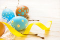 Easter eggs with twigs and ribbon on white linen backgroung close up copy space horizontal Royalty Free Stock Photography