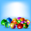 Easter eggs with various patterns and colors on blue background with space for text Royalty Free Stock Images