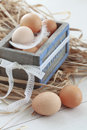 Easter eggs in a vintage wooden tray closeup Royalty Free Stock Photos