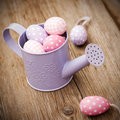 Easter eggs in watering can Royalty Free Stock Image