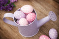 Easter eggs in watering can Royalty Free Stock Photos