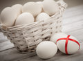 Easter eggs white in the basket Stock Images