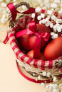 Easter eggs in the whitish nest and white flowers on beige table Stock Photography