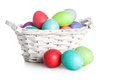 Easter eggs in a wicker basket on white background Stock Photo