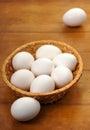 Easter eggs wicker bowl Stock Photos