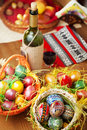 Easter eggs wine and ornaments on table Royalty Free Stock Photography
